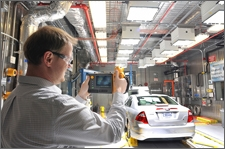 Engineer uses a thermal camera to check temperatures during hot testing. The Advanced Powertrain Research Facility's Environmental Test Cell is equipped to evaluate vehicles and components under extreme hot and cold temperature conditions (from 20F to 95F).