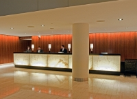 Photo of a reception desk in a hotel lobby featuring LED lighting.