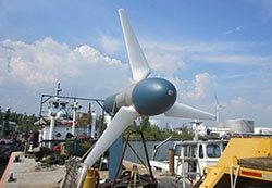 Photo of a turbine designed for the ocean situated on the shore.