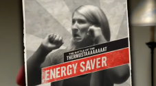 Image from the video with a woman with arms raised and the words Energy Saver on the screen.