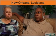 Photo of a man and a woman seated, with the man facing an interviewer off-camera, and the words across the top: New Orleans, Louisiana.