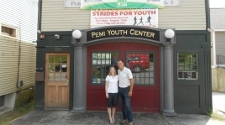 Photo of a man and woman standing outside the front entrance of the Perni Youth Center.