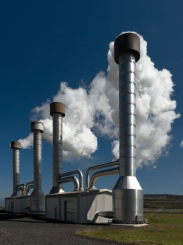 Photo of steam pouring out of a geothermal plant.