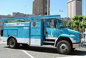 Photo of a large blue truck with 'PG&E Cleanair' written on the side.