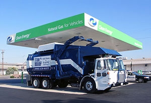 Photo of a large truck stopped at a gas station that reads 'Natural Gas for Vehicles.'