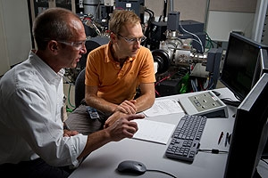 Photo of two male researchers looking at results on a computer screen.