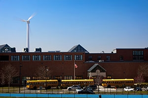 Photo of a turbine behind a school.