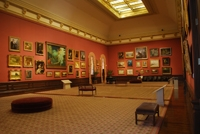 Photo of a museum gallery with LED lighting in track fixtures overhead.