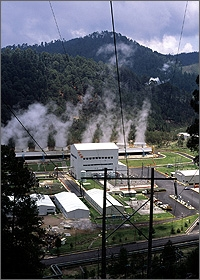 Photo of a geothermal power plant emitting steam.
