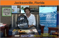 Photo of a man in an office or home, facing the camera, holding a backpack, with signage all around him. His name, from the text over the bottom of the screen, is David Reed, EA conservation coordinator. The headline over the photo reads 'Jacksonville, Florida.'