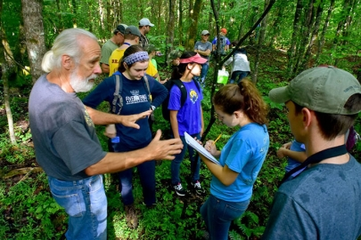 CRESO Director John Byrd provides direction to students gathering data for their research on the region's box turtle. The organization's study of turtles is the largest in the world.