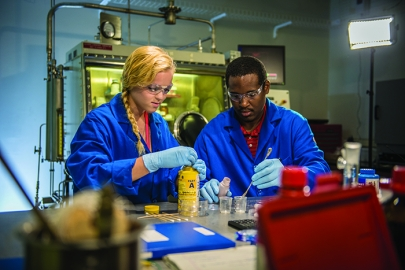 A researcher and intern create a filler for contaminant shielding at the Savannah River National Laboratory.
