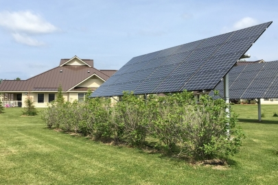 Six PV arrays generate 32 kW of energy to power 20 units at the AHA Sunrise Acres housing complex on the Saint Regis Mohawk Reservation. Photo by Rachel Sullivan, National Renewable Energy Laboratory.