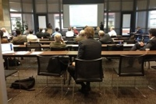 Image of a conference from the back of the room.