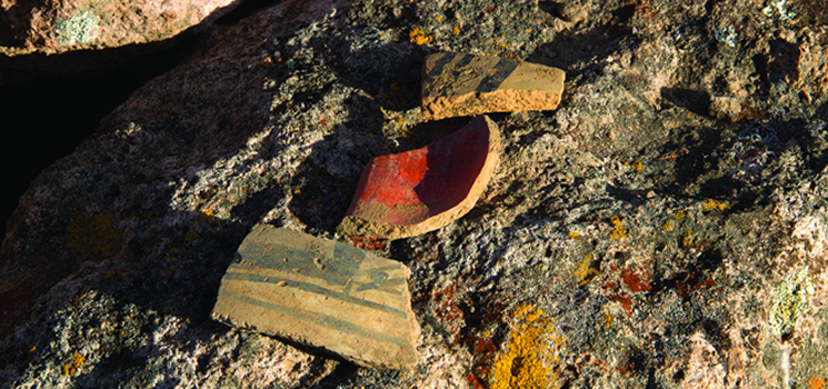 Ceramic pottery sherds at Tsirege Pueblo at Los Alamos National Laboratory. The pueblo, AD 1325-1600, consisted of hundreds of rooms.