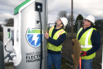 Workers put the finishing touches on installing a plug-in electric vehicle charger that is part of the West Coast Electric Highway. | Photo courtesy of Columbia-Willamette Clean Cities Coalition.