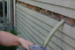 In existing homes, cellulose (here) or other loose-fill materials can be installed in building cavities through holes drilled (usually) on the exterior of the house. After the installation, the holes are plugged and finish materials replaced. | Photo courtesy of Cellulose Insulation Manufacturers Association.