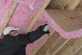 Fit insulation between joists