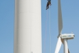 In this August 2013 photo, Pete Johnson of Gemini Rope Access Solutions rappels down a 3 megawatt Alstom wind turbine, just having finished inspecting the blades above him. The turbine was undergoing testing at NREL's National Wind Technology Center in Boulder, Colorado. | Photo courtesy of Dennis Schroeder, NREL.