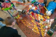 "Last week, Argonne National Laboratory hosted the 18th annual Rube Goldberg Machine Contest, which gathered nine high school teams in a competition to build a series of simples tasks, combining the principles of physics and engineering. By using common objects like marbles and bicycle parts, the students were assigned to build a machine that takes at least 20 steps to hammer a nail. In this photo, members of a Hoffman Estates High School team works on assembling a Toyland-themed Rube Goldberg machine. Check out more <a href=""http://www.flickr.com/photos/argonne/sets/72157633023662385/with/8568153243/"" target=""_blank"">photos of the competition's complex and colorful Rube Goldberg machines</a>. 