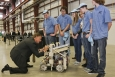 "Tennessee Governor Bill Haslam signs the robot of Hardin Valley Academy's FIRST robotics team during the dedication of DOE's Carbon Fiber Technology Facility, located at Oak Ridge National Laboratory. The RoHAWKtics team (named after their school mascot) spent an intense six weeks constructing the robot, using design, engineering, and problem-solving skills. The team will be moving on to a national competition in April. Learn more about the <a href=""http://www.ornl.gov/info/features/get_feature.cfm?FeatureNumber=f20130401-00"">FIRST competition</a>. 
