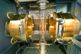 Many of the materials that scientists work with at Brookhaven National Laboratory are too small and too precise for traditional tools. In cases like these, the labs grow materials instead of building them. Brookhaven physicist Genda Gu pioneered techniques that grow some of the largest single-crystal high-temperature superconductors in the world. The glowing chamber in this photo grows superconducting crystals. To do so, the furnace focuses infrared light onto a rod, melting it around 4,000 degrees Fahrenheit. Under just the right conditions, the liquefied material recrystallizes as a single uniform structure, which is highly sensitive and takes about one month to form. | Photo courtesy of Brookhaven National Laboratory.