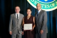 Rachel Ramirez, CEO & President of Performance Excellence Partners, accepts the  Woman-Owned Small Business of the Year Award from Kevin Knobloch, DOE Chief of Staff (l), and John Hale III, Director, DOE's Office of Small and Disadvantaged Business Utilization (r) at the Small Business Forum & Expo, Tampa, FL, on July 12, 2014