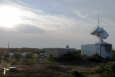 This observatory is part of an air particles research initiative at Cape Cod National Seashore in Massachusetts, and includes dozens of sophisticated instruments that take continuous ground-based measurements of clouds, aerosols, and other atmospheric properties.   Photo courtesy of the ARM Climate Research Facility.