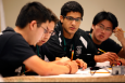 Members of the Los Alamos High School team, Los Alamos, New Mexico, concentrates on the answer to a question at the 2012 National Science Bowl in Washington D.C. on April 29, 2012. | Photograph by Dennis Brack, Office of Science