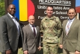 Lewann Belton, left, director of the Cyber and Information Technology Division at DOE's Savannah River Operations Office, visits the headquarters of the U.S. Army Cyber School at Fort Gordon, Ga. He was greeted by the school's staff, from left, Todd Boudreau, deputy commander; Maj. Charlie Lewis, chief of the Cyber Leader College; and Thomas Barnes, director of Cyber Training and Education.
