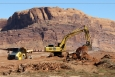 Debris from the former mill buildings at the Moab site is excavated from the mill tailings pile.