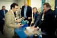Oak Ridge National Lab's Ayyoub Momen demonstrates ultrasonic clothes dryer technology for David Danielson, Assistant Secretary for Energy Efficiency and Renewable Energy (EERE)