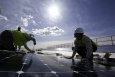 Workers install photovoltaic modules on top of a parking structure at National Renewable Energy Laboratory in Golden, Colorado. The Energy Department has several training resources for energy and manufacturing workers. | Photo by Dennis Schroeder, National Renewable Energy Laboratory