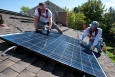 Home solar systems can save you energy and money. | Photo courtesy of Dennis Schroeder, NREL 22168.