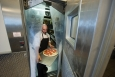 "Dale Linkous carries pizza out of the walk-in freezer in the kitchen at the National Renewable Energy Laboratory in Golden, Colorado. The Energy Department <a href=""http://energy.gov/articles/new-energy-efficiency-standards-commercial-refrigeration-equipment-cut-businesses-energy"">announced new energy efficiency standards</a> for commercial freezers and refrigerators. 