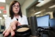 A researcher loads a biomass sample into spinning ring cup. Argonne National Laboratory has launched two online tools that assess the resource consumption and greenhouse gas emissions associated with biofuel production.   Photo courtesy of National Renewable Energy Laboratory