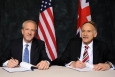 DOE Senior Advisor for Environmental Management David Huizenga (left) and Mark