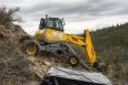 A spider excavator extracts mercury-contaminated soil.