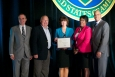 Leanne Stribley (center), with Sonny Rogers and Cassandra Stuart, of ORNL, accepts the DOE Mentor of the Year Award from Kevin Knobloch, DOE Chief of Staff, and John Hale III, Director of DOE's Office of Small and Disadvantaged Business Utilization at the Small Business Forum & Expo, Tampa, FL, on July 12, 2014