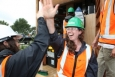 Amanda Crosby, right, and Belinda Dods of New Zealand celebrate placing the final screw on the deck of their house at Solar Decathlon 2011.