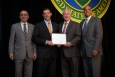DOE Chief of Staff Kevin Knobloch (l) and DOE OSDBU Director John Hale III (r) present Service-Disabled Veteran-Owned Small Business of the Year to BNL Tech President and Chief Financial Officer Wilson Stevenson and BNL Tech Chief Executive Officer Bill Woody