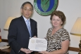 Secretary Chu presents the Secretary of Energy's Appreciation Award to Judy A. McLemore.