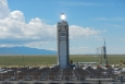 Sunlight reflected from heliostats is shining directly on the particle receiver, which is currently being tested on top of the solar tower at the National Solar Thermal Test Facility.