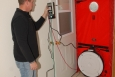A tribal member practices setting up and operating a blower door during an energy audit training at the tribal sports arena, Chi-Mukwa. Photo from Kathie Brosemer, Sault Ste. Marie Tribe of Chippewa Indians, NREL 32756