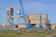 Workers remove the old test vessel from the Full-Scale Vessel Test Facility.
