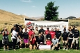 Bechtel employees celebrate a $100,000 gift to Friends of Badger Mountain at Trailhead Park in Richland.