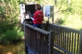 An innovative computerized process now used at SRS allows for highly efficient management of environmental sampling information. SRNS Environmental Monitoring Program Field Technician Rebecca Sturdivant checks the calibration of a flowmeter installed near a small stream at SRS.
