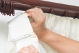 Hanging drapes or blinds soon after moving is a small step that can have an immediate effect on the comfort of your home. | Photo courtesy of iStockphoto.com/powershot.
