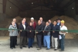 On April 20, Office of Indian Energy Director Chris Deschene (second from right) joined other key stakeholders for the official opening of the Menominee Tribal Enterprises biomass combined heat and power district energy plant in Wisconsin. Photo from Menominee Tribal Enterprises.