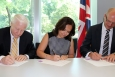 From left to right, DOE Office of Nuclear Energy Deputy Assistant Secretary for Fuel Cycle Technologies John Herczeg, EM Associate Principal Deputy Assistant Secretary Monica Regalbuto, and UK National Nuclear Laboratory Managing Director Paul Howarth sign a Statement of Intent amendment at the British Embassy in Washington, D.C.
